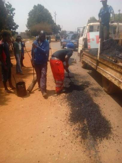 Honourable Madambo fixing roads in his constituency